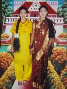 Rehana (left), late twenties, with a friend in a Nischintapur studio. Missing.