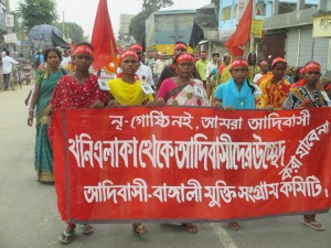 "We are not nri-gushti (a derogatory term recently introduced by the Bangladesh government for the ethnic minorities) we are adibashi (A preferable term for indigenous people). Their banner says: ""Displacement of adibashi from the mining vicinity will not be tolerated"". They are organized under Adibashi-Bengali mukti shongram committee."