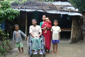Family of Bablu Roy and Shondhya Rani. Bablu was a van driver and only 28 years old when he joined the demonstration to seize the office of Asia Energy on August 26, 2006. He was injured by bullets on his lower part of spinal cord when the state armed forces open fired on the demonstration. The photo was taken in 2007 after he returned home after one year spending in hospital.